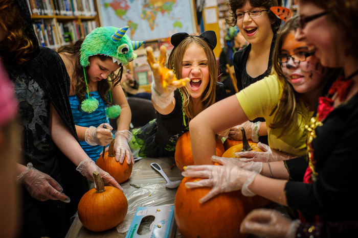 Girl Power! attendees carve pumpkins for Halloween